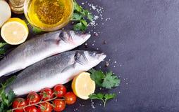 Fresh fish sea bass. On dark background Stock Photo