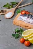 Fresh fish sea bass. On wooden table Stock Photos