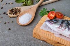 Fresh fish sea bass. On wooden table Stock Photo