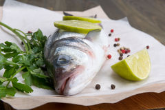 Fresh fish - sea bass. Pepper and lime Royalty Free Stock Image
