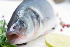 Fresh fish - sea bass. Pepper and lime Stock Photos