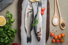 Fresh fish sea bass on wooden table.  Stock Image