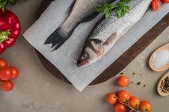 Fresh fish sea bass on wooden table.  Stock Photo