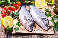 Fresh fish sea bass. On wooden table Stock Photography