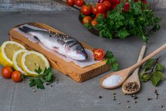 Fresh fish sea bass. On wooden table Royalty Free Stock Images