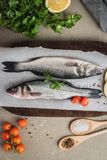 Fresh fish sea bass on wooden table.  Stock Photography