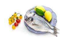 Fresh fish sea breamsSparus aurata on a plate. royalty free stock photography