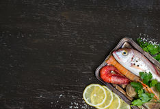 Fresh fish and seafood. On a dark vintage background Stock Photos