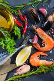 Fresh fish and seafood with herbs background Stock Images