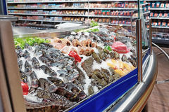 Fresh fish and seafood on iced market display, toned Royalty Free Stock Photos