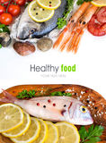 Fresh fish, seafood and vegetables. Isolated on white Royalty Free Stock Photography