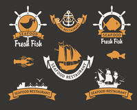 Fresh fish. Set of logos for restaurants and seafood stores with the image of fish and ships Stock Images