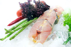 Fresh fish sliced on white background decorated stock photography