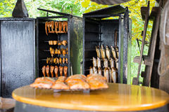 Fresh fish in smoker Royalty Free Stock Images