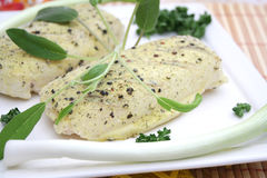 Fresh fish. Some frozen fish with pepper seeds Royalty Free Stock Photography
