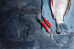 Fresh fish with spices on a stone board Royalty Free Stock Photos