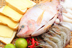 Fresh fish, squid, shrimp, streaky pork, sausages - for cooking. Royalty Free Stock Images