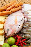 Fresh fish, squid, shrimp, streaky pork, sausages - for cooking. Stock Photo