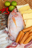 Fresh fish, squid, shrimp, streaky pork, sausages - for cooking. Stock Images
