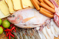 Fresh fish, squid, shrimp, streaky pork, sausages - for cooking. Royalty Free Stock Photography