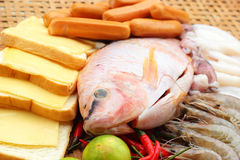 Fresh fish, squid, shrimp, streaky pork, sausages - for cooking. Stock Photography