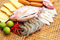 Fresh fish, squid, shrimp, streaky pork, sausages - for cooking. Stock Image
