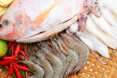 Fresh fish, squid, shrimp, streaky pork, sausages - for cooking. Royalty Free Stock Photo