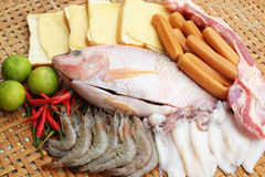 Fresh fish, squid, shrimp, streaky pork, sausages   Royalty Free Stock Image