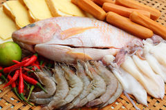 Fresh fish, squid, shrimp, streaky pork, sausages - for cooking. Royalty Free Stock Photos