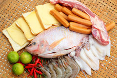 Fresh fish, squid, shrimp, streaky pork, sausages - for cooking. Stock Photos