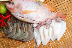Fresh fish, squid, shrimp, streaky pork, sausages - for cooking. Royalty Free Stock Image