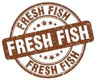 Fresh fish stamp. Fresh fish round grunge stamp isolated on white background Royalty Free Stock Photo