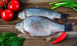 Fresh fish with tomatoes, pepper, green onions and fennel Stock Image