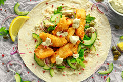 Fresh Fish Tortilla with cucumber, red onion, Capers, lemon, salad leaves and tartare sauce. Healthy Food Stock Images