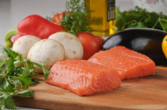 Fresh fish with vegetables Stock Photography