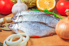 Fresh fish and vegetables on a cutting board Stock Image