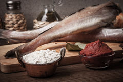 Fresh fish, vegetables, flour, tomatoe paste and spices on a woo Royalty Free Stock Images