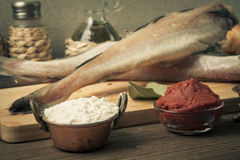 Fresh fish, vegetables, flour, tomatoe paste and spices on a woo Stock Photography
