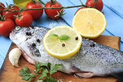 Fresh fish with vegetables and lemon Royalty Free Stock Image