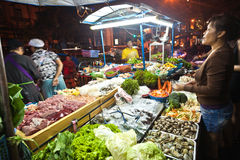 Fresh fish and vegetables  offered Stock Images