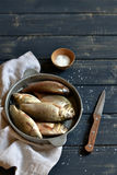 Fresh fish in a vintage pan Stock Images