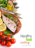 Fresh fish on a wooden board Stock Photography