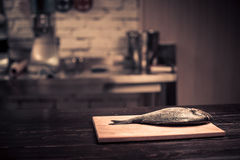 Fresh fish on a wooden cutting board Stock Image