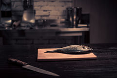 Fresh fish on a wooden cutting board Stock Photo