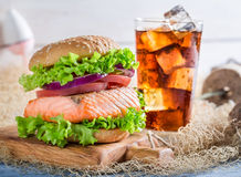 Fresh fishburger with salmon made by fisherman Royalty Free Stock Photos