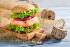 Fresh fishburger with salmon Stock Photos