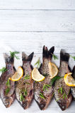 Fresh fishes with lemon Royalty Free Stock Photography