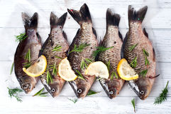 Fresh fishes tails with lemon Royalty Free Stock Photography