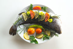 Fresh fishes with vegetables Stock Photos