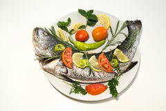 Fresh fishes with vegetables Stock Photography